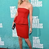 Charlize Theron in a red dress at the 2012 MTV Movie Awards.