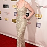 Anne Hathaway, armed with a megawatt smile, shined bright in gold bugle-beaded Oscar de la Renta slipdress, which proved statement-making and totally sexy.