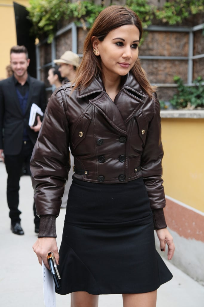 A voluminous aviator-style jacket provides a slick contrast to a trumpet hem skirt. Source: Greg Kessler