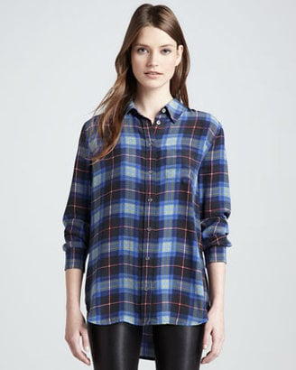 With the '90s grunge trend back with a vengeance, Equipment Reese punk plaid blouse ($248) seems super relevant right now. I like that, unlike other plaid shirts, the high/low hemline gives it a feminine twist. I will definitely be tying this one around my waist and wearing it over all my favorite tanks. — Melody Nazarian, associate editor