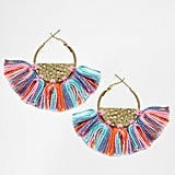 These Glamourous Semi Circle Hoop Tassel Earrings ($10) will add a vibrant finishing touch to any look.