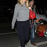 Gwyneth Paltrow Wearing a Gray Sweater and Red Bag
