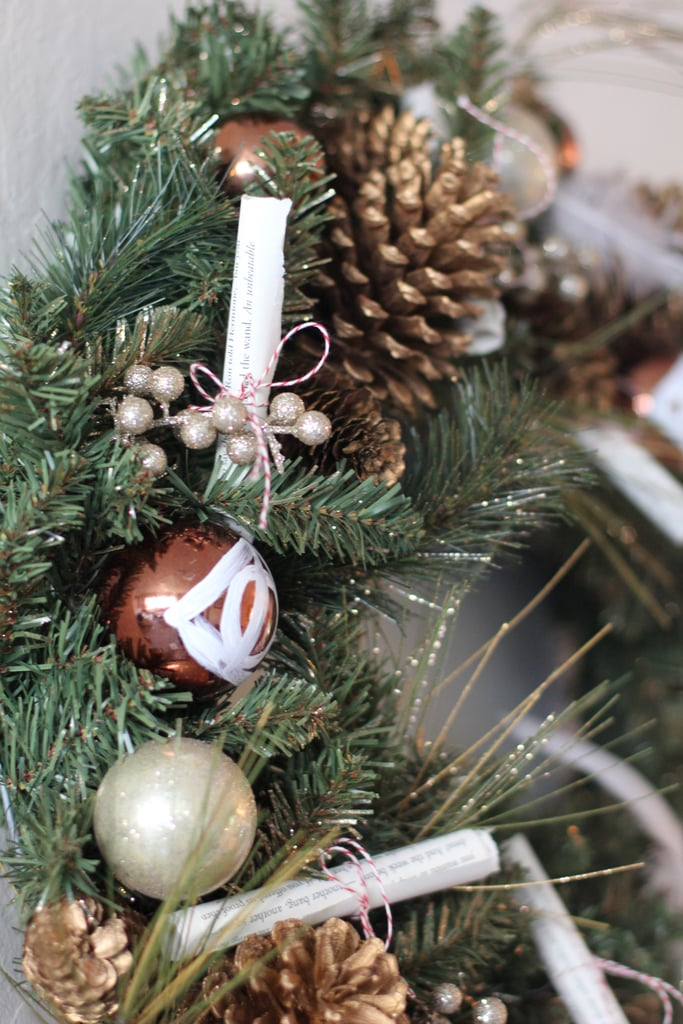 Buy a traditional wreath and add scrolls from the book pages plus DIY Deathly Hallows ornaments.