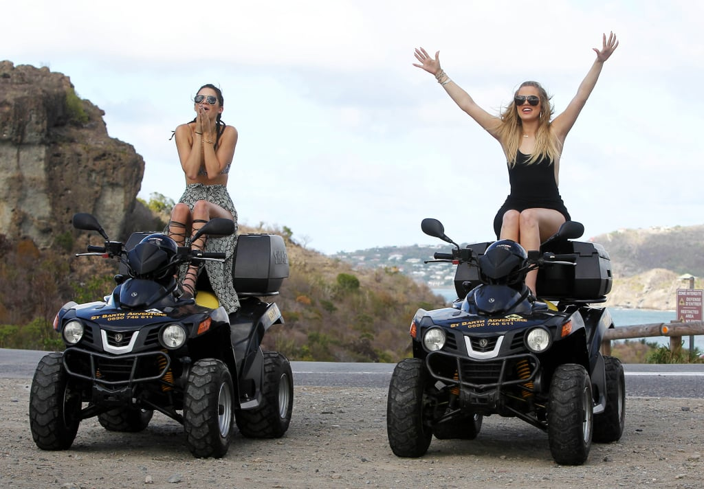 The Kardashian-Jenner crew arrived in St. Barts on Monday and promptly hit the town wearing the perfect vacation looks. Later that day, Kendall and Khloé wasted no time getting into the vacation fun, hopping on ATVs to go four-wheeling around town. The exciting activities continued on Tuesday when Kourtney, Khloé, Kendall, and Kylie all boarded a boat in their stylish swimwear to go parasailing. They aren't the only stars enjoying a getaway — check out all the stars on hot Summer vacations that are sure to make you jealous.
