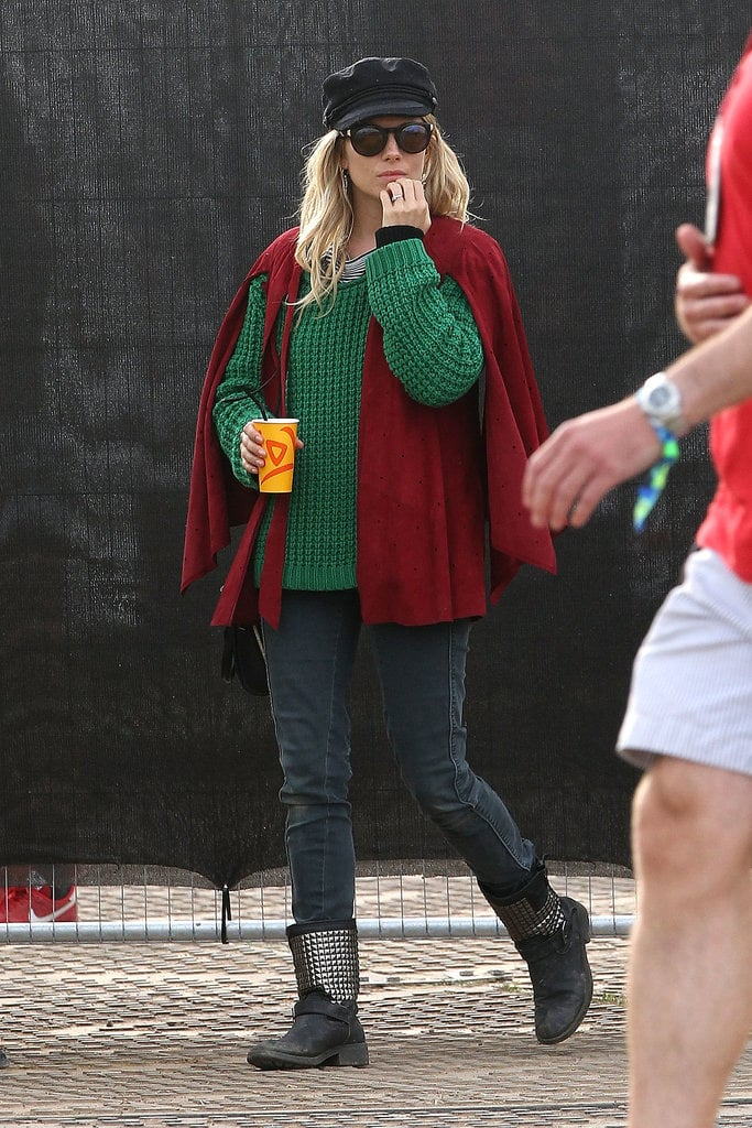 Sienna Miller wore a cape at Glastonbury.