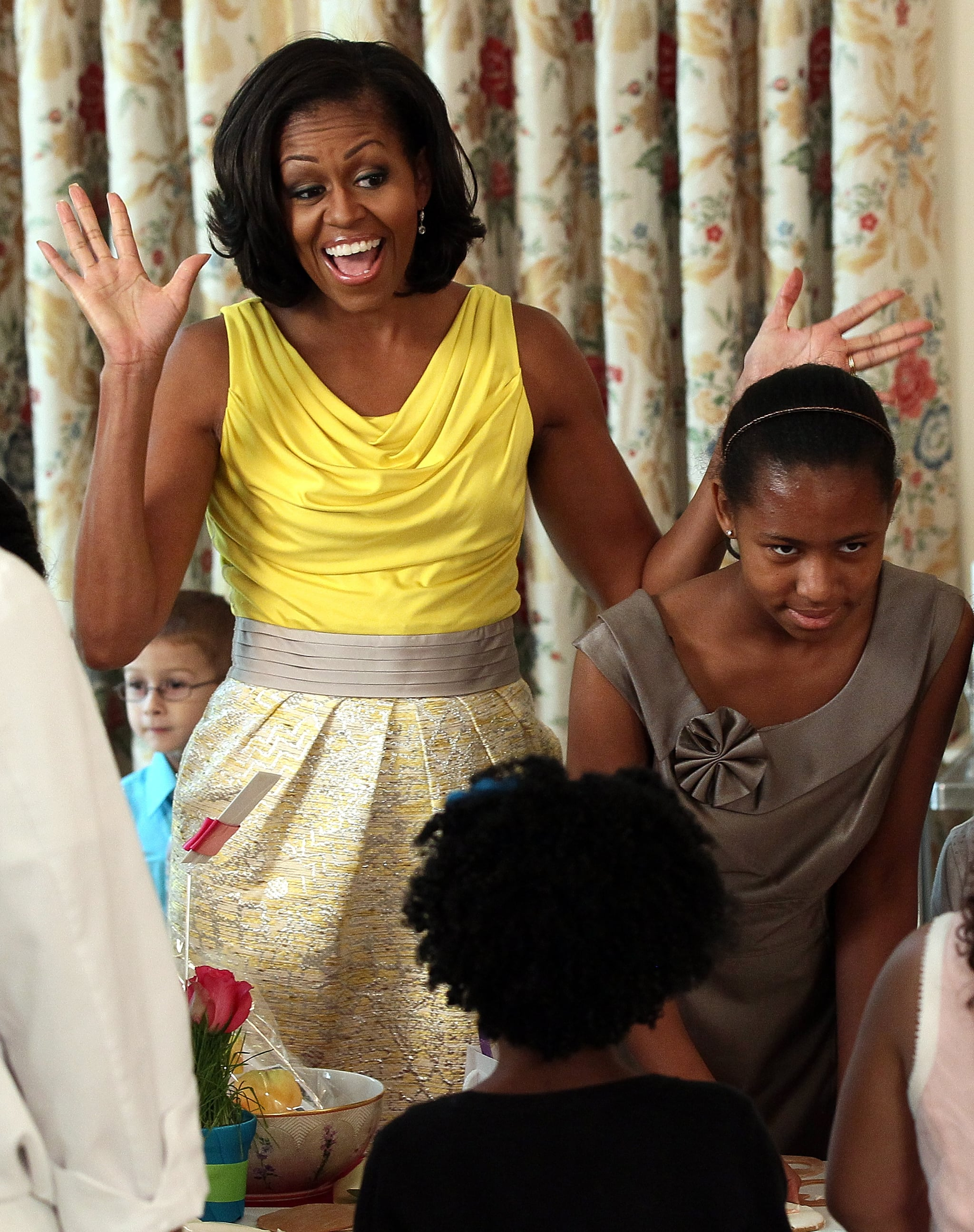 Michelle attended a Mother's Day event in a sunny yellow Rachel Roy dress that she's worn before.