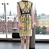 We're loving this yellow painted Lanvin sheath she wore to the Moscow photo call. To edge it up, she added stacked rings and Brian Atwood peep-toe pumps.
