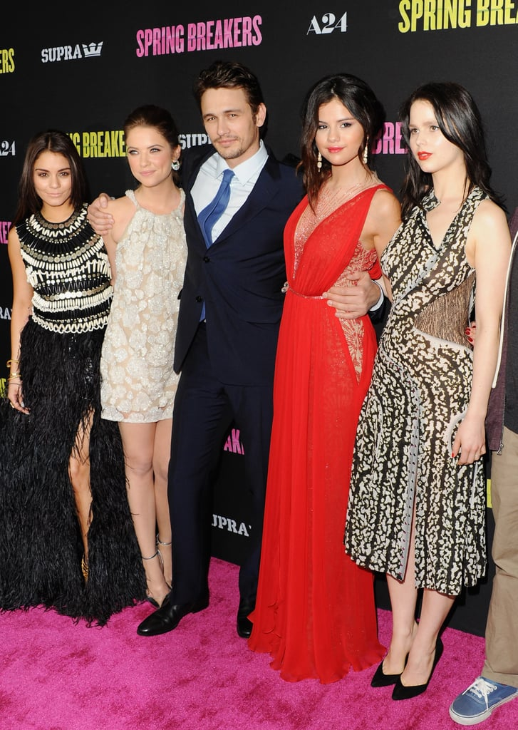 Selena Gomez was the lady in red last night when she attended the Spring Breakers LA premiere in a crimson-colored Reem Acra gown. She was joined by her costars James Franco, Ashley Benson, and Vanessa Hudgens, who wore a dramatically feathered Naeem Khan frock to the event. It was a big night for young Hollywood, as other celebrity attendees included Ashley's Pretty Little Liars costar Shay Mitchell, Modern Family star Sarah Hyland, and Vanessa Hudgens's High School Musical friend Ashley Tisdale. This marks the first official stateside premiere of the highly anticipated flick, but the cast did host a special screening of Spring Breakers at SXSW on Sunday. It's also Selena's first public appearance since an alleged new song was leaked off of her upcoming album.