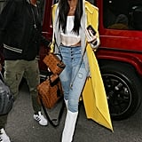 Winnie Harlow Arrived at the BFC Show Space in London in Jeans, White Boots, and a Yellow Norma Kamali Jacket