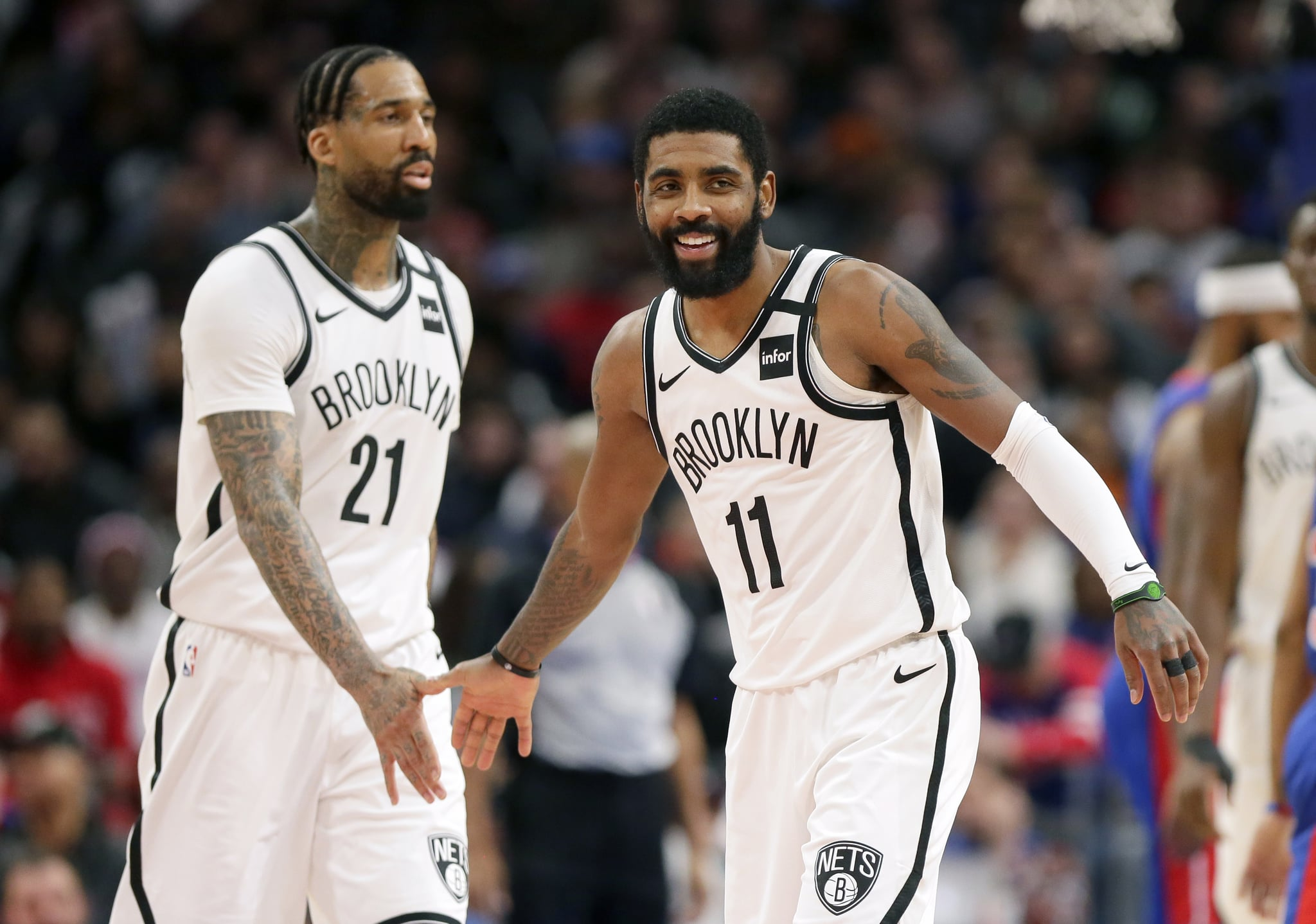 DETROIT, MI -  JANUARY 25:  Kyrie Irving #11 of the Brooklyn Nets celebrates with Wilson Chandler #21 of the Brooklyn Nets during the second half of a game against the Detroit Pistons at Little Caesars Arena on January 25, 2020, in Detroit, Michigan. The Nets defeated the Pistons 121-111 in overtime. NOTE TO USER: User expressly acknowledges and agrees that, by downloading and or using this photograph, User is consenting to the terms and conditions of the Getty Images License Agreement. (Photo by Duane Burleson/Getty Images)