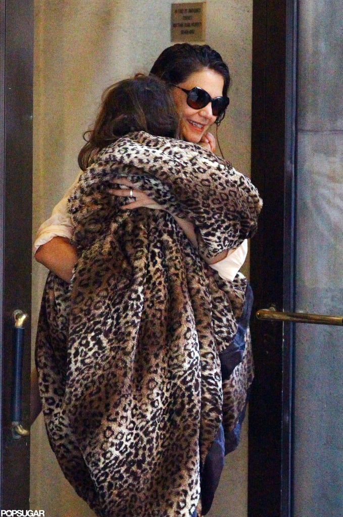 Katie Holmes carried Suri Cruise out of their NYC apartment in a leopard print blanket.