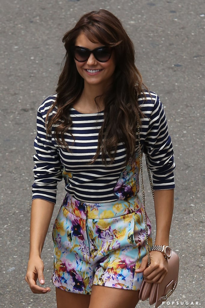 Nina Dobrev put on a smile as she arrived to promote The Vampire Diaries at Comic-Con.