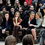 Eddie Redmayne and Rosie Huntington-Whiteley focusing while Kate Bosworth and Mario Testino chat as Burberry models took to the runway.