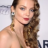 Also opting for vintage flair, model Eniko Mihalik paired gorgeous curls with dewy skin and crimson lipstick.
