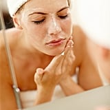 "The risks associated with exfoliating too much go far beyond a temporarily irritated complexion. ""Over-exfoliating can lead to uneven skin tone and texture and increased sensitivity to all products in your skin-care routine,"" said Dr. Ross. Because over-exfoliating damages the outer layer of your skin, it makes you less likely to be able to tolerate many active ingredients in other skin-care products.  And you know how exfoliating properly can help reduce your chances of breaking out, as it removes dead skin cells and debris from the surface of your complexion before it clogs pores? Well, overdoing it can have a reverse effect. ""Another common problem associated with too much exfoliation is acne,"" Dr. Ross said. ""You can actually develop pimples on the skin which is typically the opposite of the outcome you are trying to achieve."""