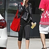 Nicole Richie gave her all-black look a pop with a bright red Delvaux 24 Heures Santiag leather satchel.