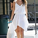 Rachel Bilson spent a day running errands in LA in an asymmetrical-hem LWD and Tkees flip-flops. Easy, breezy, beautiful.