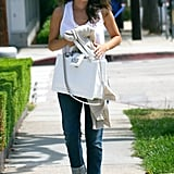 Rachel recently paired her Chanel bag with a relaxed tank and boyfriend jeans.