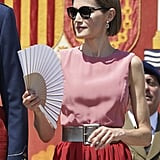 Queen Letizia carried the perfect accessory in July.