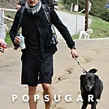 Orlando Bloom and Flynn Bloom walked with their dog.