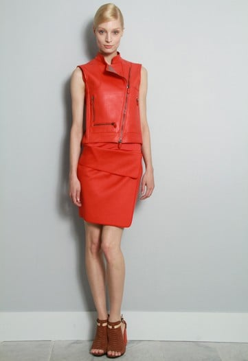 ">> The always art and architecture-influenced Reed Krakoff settled on the abstract stain paintings of the early '60s and their saturated hues for his Resort 2012 inspiration. The resultant emerald greens, Yves Klein blues, and tomato reds made their way onto leather suiting and python wrap skirts, mixed in with transparent chain mail pieces. But Krakoff wasn't a 2011 CFDA Accessory Designer of the Year nominee for nothing — his latest offering includes T-strapped sandals, chunky platforms, Klein blue <product target=""_blank"" href=""http://www.style.com/fashionshows/review/2012RST-RKRAKOFF"">matte python satchels</product>, and extra-small evening clutches."