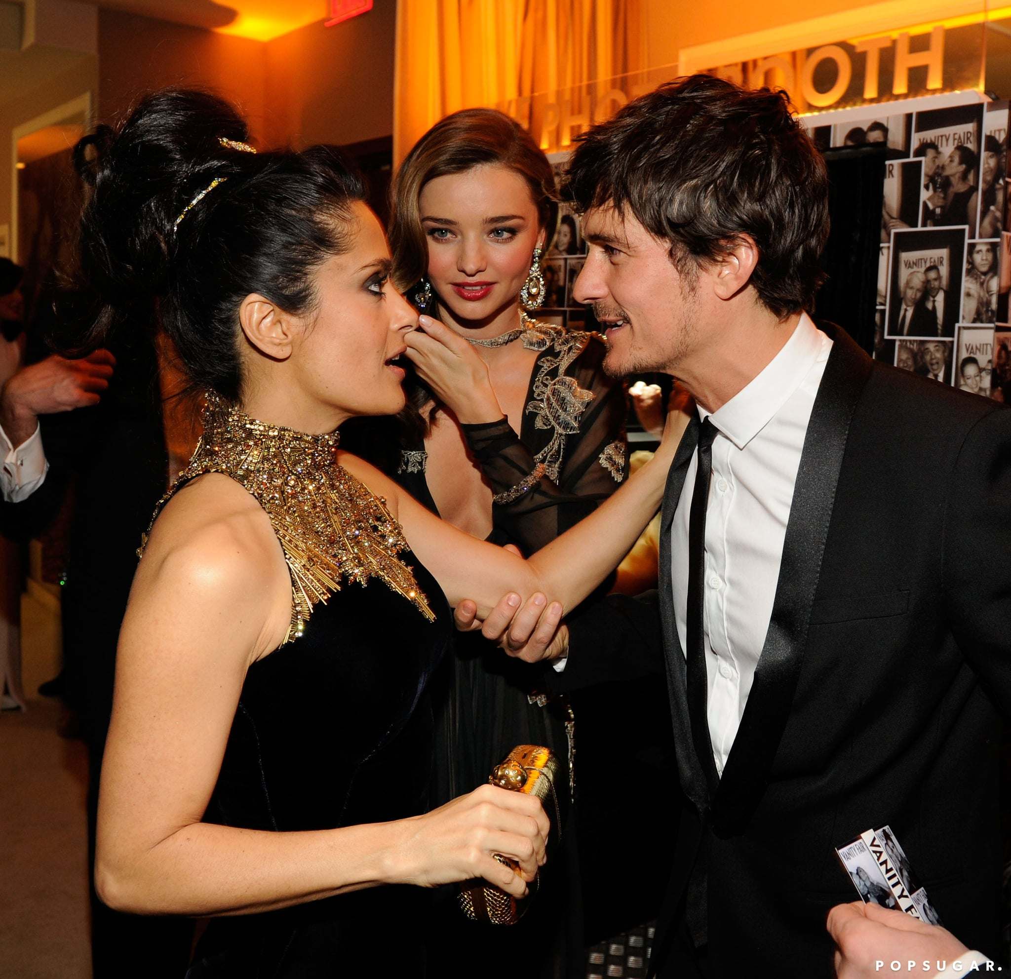 Salma Hayek greeted Orlando Bloom and Miranda Kerr at Vanity Fair's Oscar after-party.