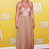 Miranda Lambert was a vision in a blush-hued Maria Lucia Hohan number. The halter-style dress gave way to a flowy, diaphanous chiffon skirt — in our opinion, a very pretty juxtaposition for the red carpet.