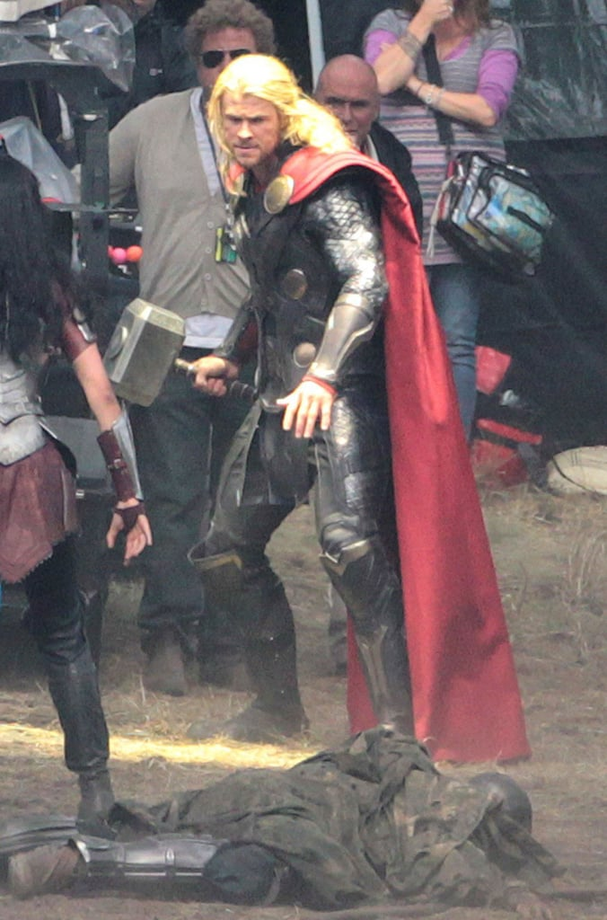 There's going to be a long wait before the next Avengers movie, but rest assured we'll still get to spend some time with the superheroes — in individual doses that is. Chris Hemsworth is already hard at work on the sequel to Thor, which has been recently titled Thor: The Dark World. Filming is happening overseas in England, where Hemsworth was spotted on set alongside his stunt double and costar Jaimie Alexander (who will be reprising her role as Sif). There's not much in the way of spoilers here other than the fact that Thor is taking down the bad guys as usual, but who doesn't love to see a suited-up Hemsworth?