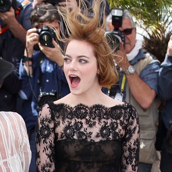 Emma Stone Battles Windy Weather at Cannes With a Big Smile