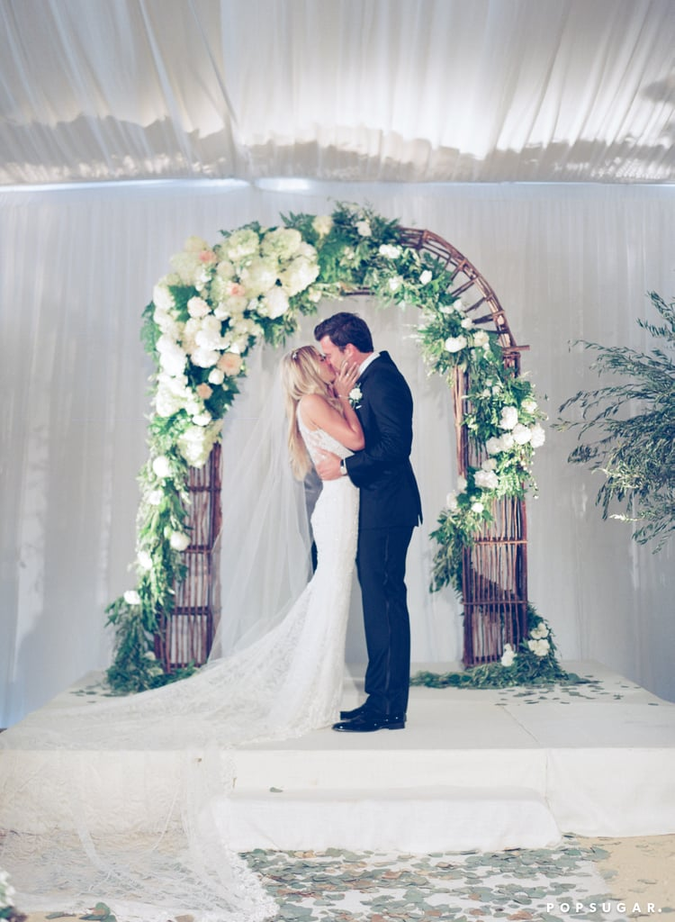 """Lauren Conrad married William Tell in September 2014, and we've rounded up the pictures that you loved most from their gorgeous wedding along the California coastline. In her typical superstylish fashion, Lauren's ceremony was tasteful and elegant with a touch of whimsy. The bride wore a Badgley Mischka couture gown for her nuptials, which she described as """"rustic-chic"""" and featured Pinterest-perfect details like vintage decor and homemade apple pies. She had 10 bridesmaids at the altar with her, including her younger sister Breanna and longtime friend Lo Bosworth; Lauren revealed her decision to have a larger bridal party in a blog post, saying, """"I knew that having a bigger bridal party with all of my best friends was the way to go. So, I chose my sister and a bunch of my besties to do me the honor of being my bridesmaids, and I couldn't be happier with my decision.""""  Lauren and William got engaged in October 2013 after dating for more than a year, and are currently expecting their first child. The couple keeps their relationship pretty private, but when we do get glimpses of the duo, they are adorable — and never more than on their wedding day!"""