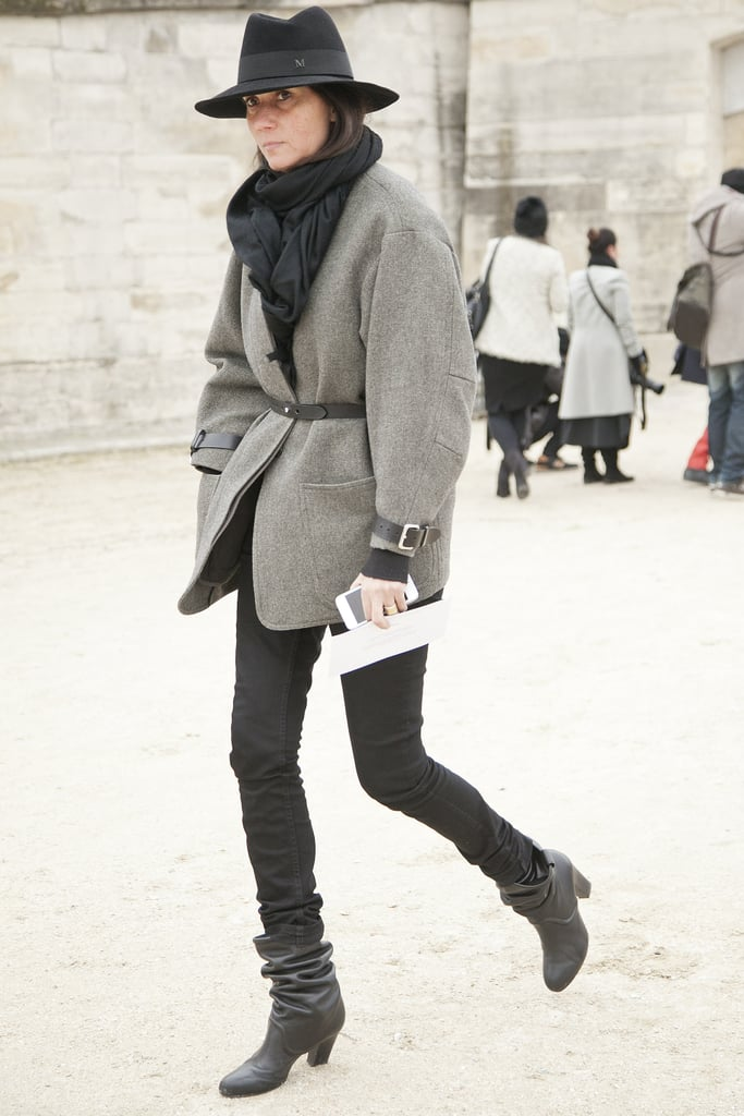 Emmanuelle Alt made her arrival in belted blazer and black denim.