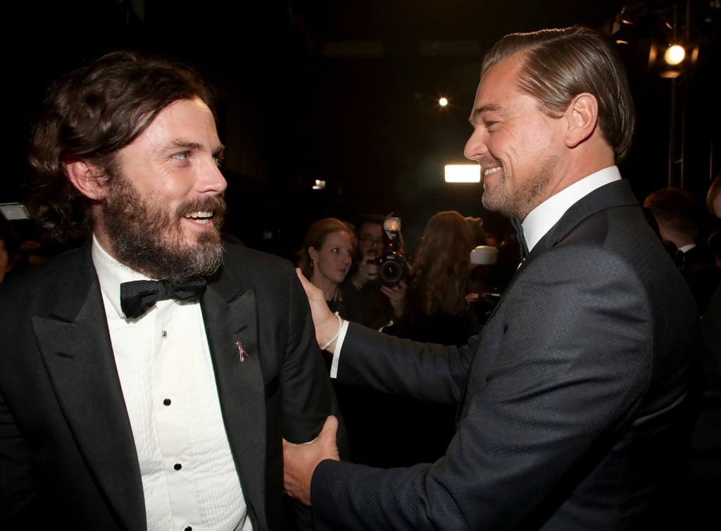 Pictured: Casey Affleck and Leonardo DiCaprio