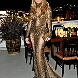 What do you wear to a private dinner in your honour? Well if you're Jennifer Lopez, a sheer, floor-length, bejewelled fishtail gown, of course.