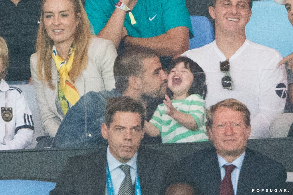 Gerard Piqué gave his son, Milan, a kiss.