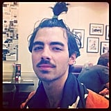 Joe Jonas showed off a pretty sweet ponytail. Source: Instagram user adamjosephj