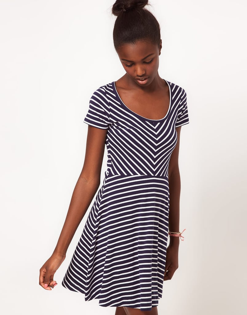 Add ankle boots and a denim vest for that everyday cool-girl effect.  Vero Moda Striped Skater Dress ($28)