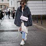 With a Furry Coat and Distressed Denim