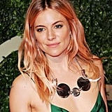 Sienna Miller's blond mane looked to have hints of pink hair color, while her makeup was soft and natural.