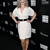 Kelly Osbourne had purple hair on the black carpet.