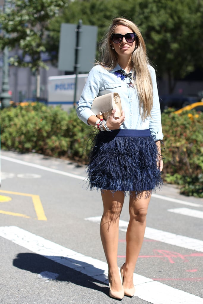 A feathered skirt played a very glamorous opposite to a chambray button-down.