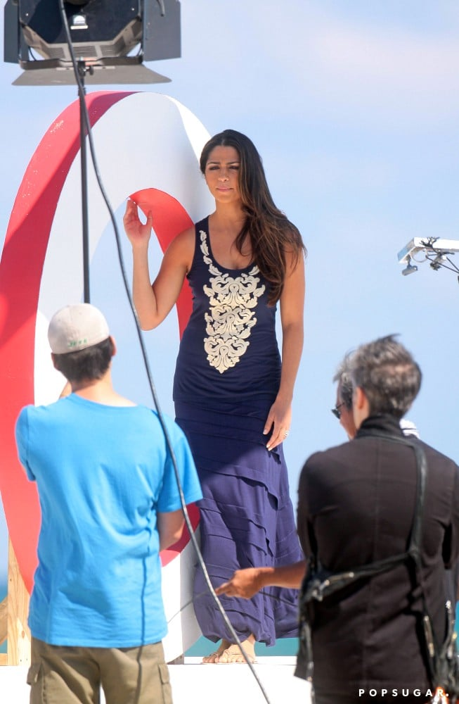 Camila Alves posed on a platform.