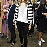 A sparkly striped Topshop bomber jacket took her jumper and skinny combo to new heights at the Topshop Unique show.