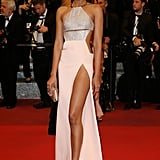 Chanel Iman showed a slip of leg in a KaufmanFranco gown at the Loving premiere.