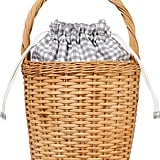 We can't get over the sweet pop of gingham on this Edie Parker wicker tote ($995).