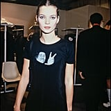 Backstage at Paris Fashion Week in 1994, wearing a statement tee.