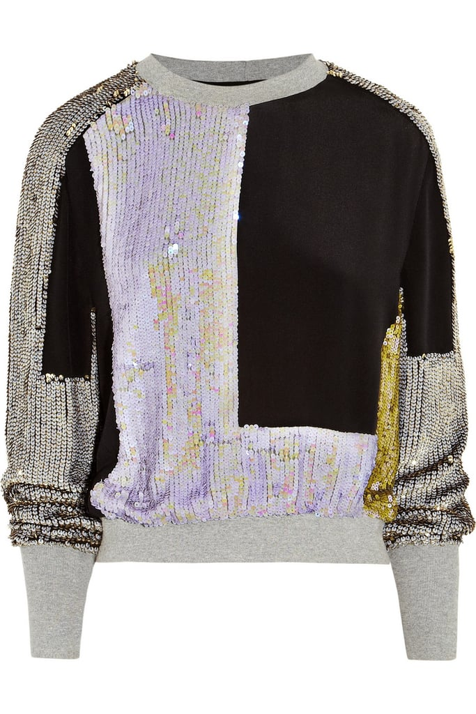 "The minute we spotted this gray silk iridescent sequined sweatshirt by Phillip Lim ($995), we knew we'd never feel the same about ""dressy"" sweatshirts. It's literally a party of one on top, with all the appeal of something comfortable and sporty. All you need is a pair of slim-cut black trousers, ankle-strap pumps, and a snakeskin clutch (just a suggestion), and you're ready to hit the party circuit."