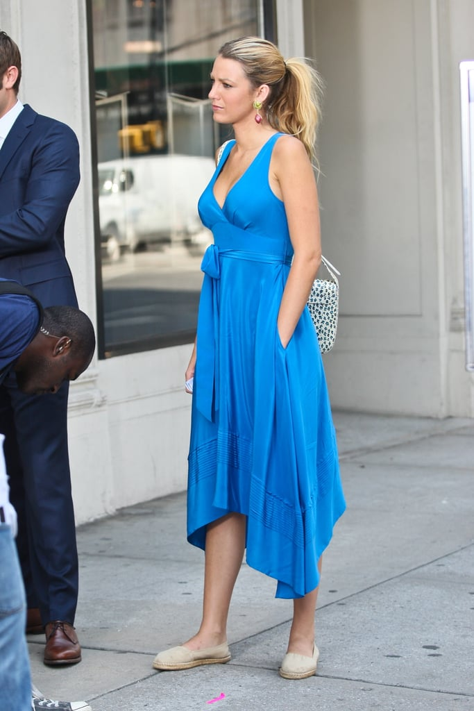 Blake Lively tucked her hands in the pockets of her dress.