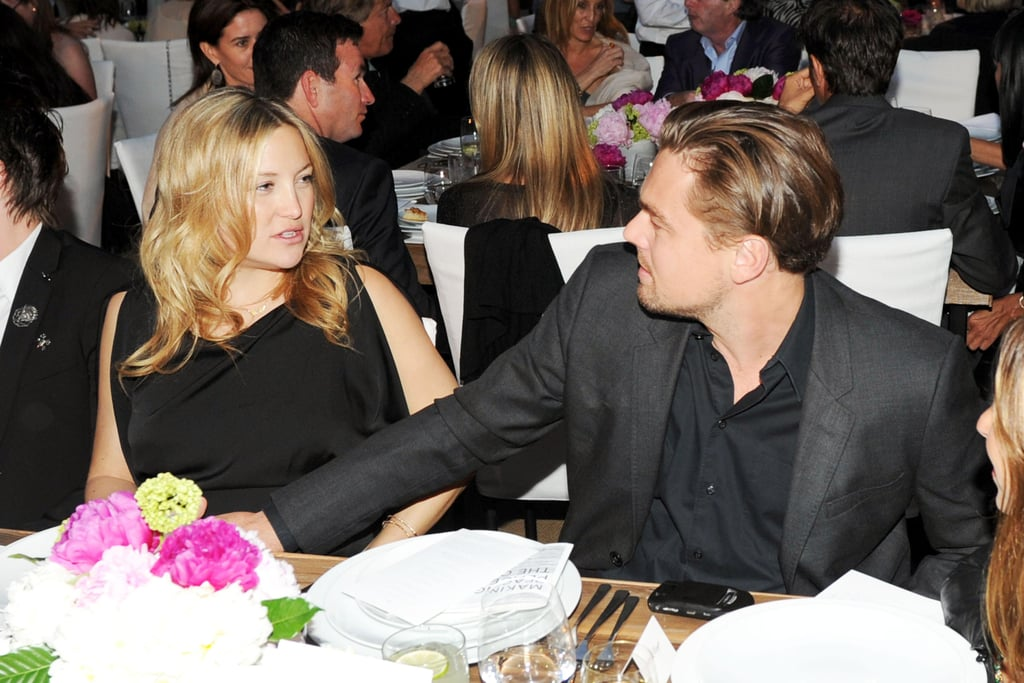 Leo chatted with Kate Hudson at a charity dinner in Malibu in June 2011.