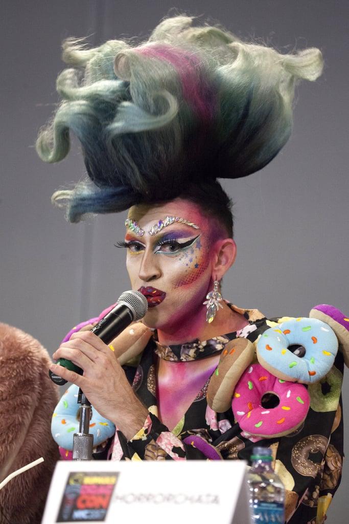 Alex Kacala spoke to an audience at DragCon while rocking rainbow hair.