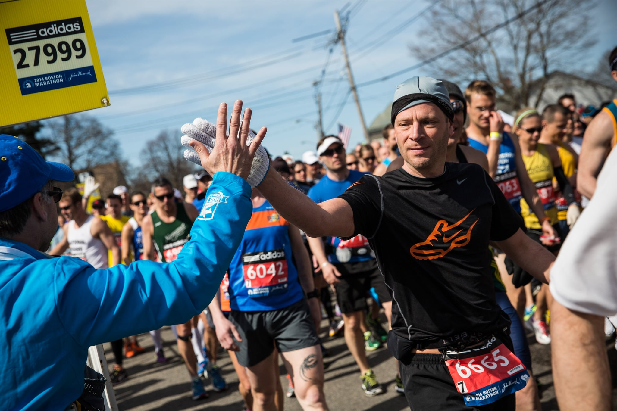 One runner gave a high five as he started the race.